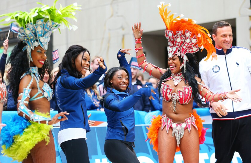 """U.S. athletes Gabby Douglas, second from left, Simone Biles and Ryan Lochte visit NBC's """"Today Show"""" set in New York City on Wednesday. The event marks 100 days until the opening ceremony of the Rio 2016 Olympic Games."""