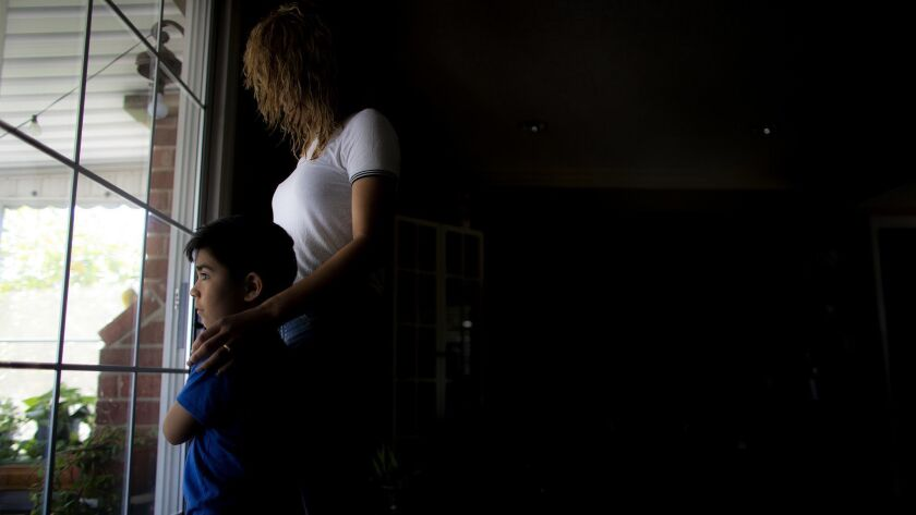FULLERTON, CA - JUNE 28, 2018: Andrea,22, with her son Mateo,4, was the beneficiary of President Oba