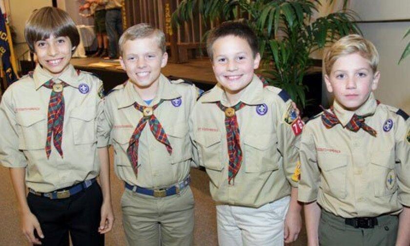 New Boy Scouts: Raymond (R.J.) Faltinsky, John Flaming, Luke Shugert, Rocco Cappetta at the bridging ceremony. Photo/Jon Clark