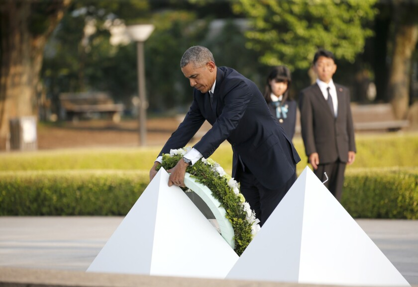 President Obama lays a wreath at the Hiroshima Peace Memorial Park in Japan on May 27.