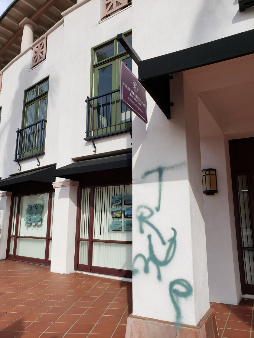 Berkshire Hathaway HomeServices at 1299 Prospect St. is pictured vandalized with spray paint the morning of June 2.