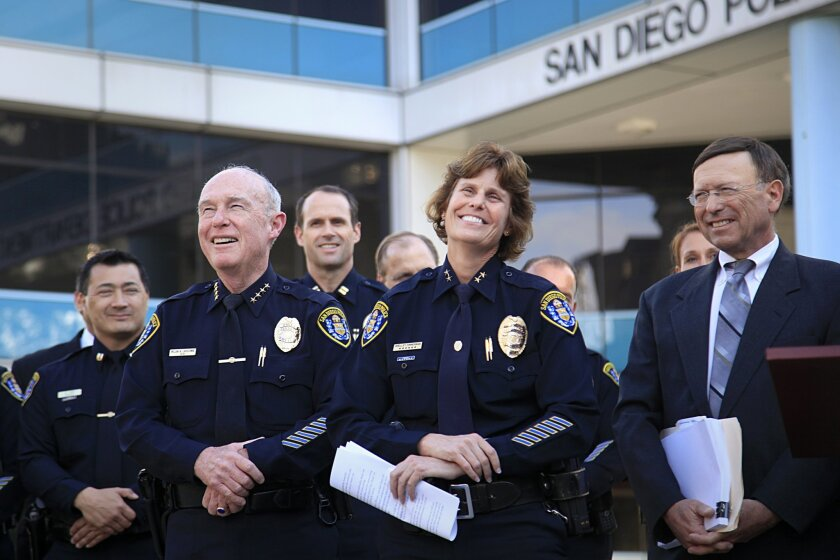 Assistant San Diego Police Chief Shelley Zimmerman, center right, and former San Diego Police Chief Bill Lansdowne, left, along with city attorney Jan Goldsmith share a laugh during a press conference where San Diego Mayor Kevin Faulconer appointed Zimmerman as chief Landsdowne following his resign