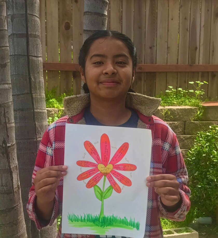 A Boys & Girls Club member with her drawing.