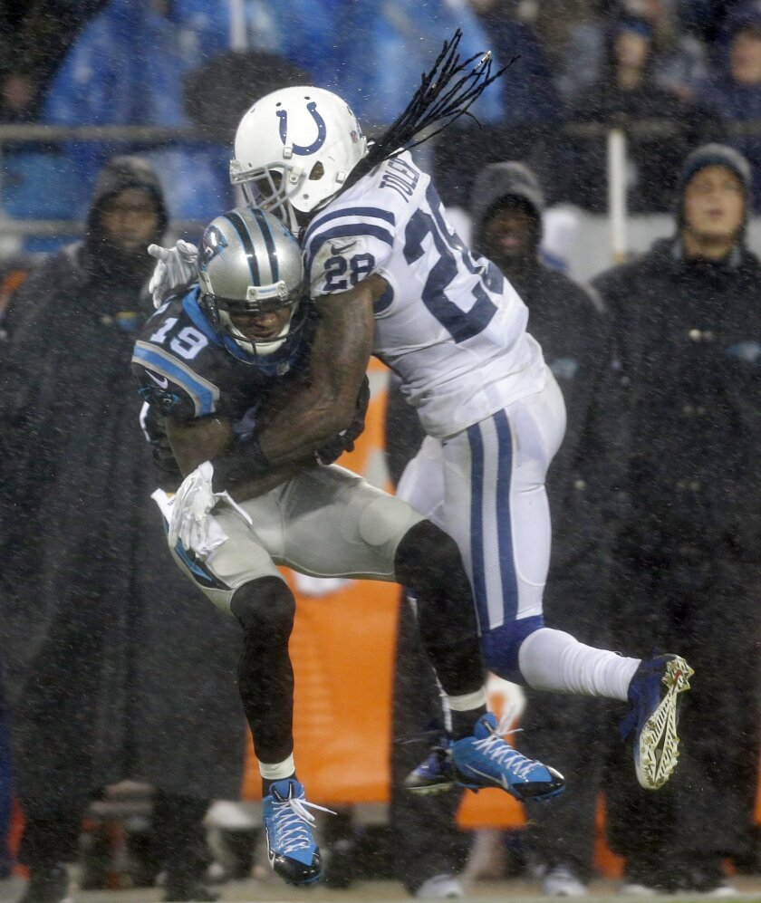 Carolina Panthers' Ted Ginn (19) catches a pass as Indianapolis Colts' Greg Toler (28) defends in the first half of an NFL football game in Charlotte, N.C., Monday, Nov. 2, 2015. (AP Photo/Bob Leverone)