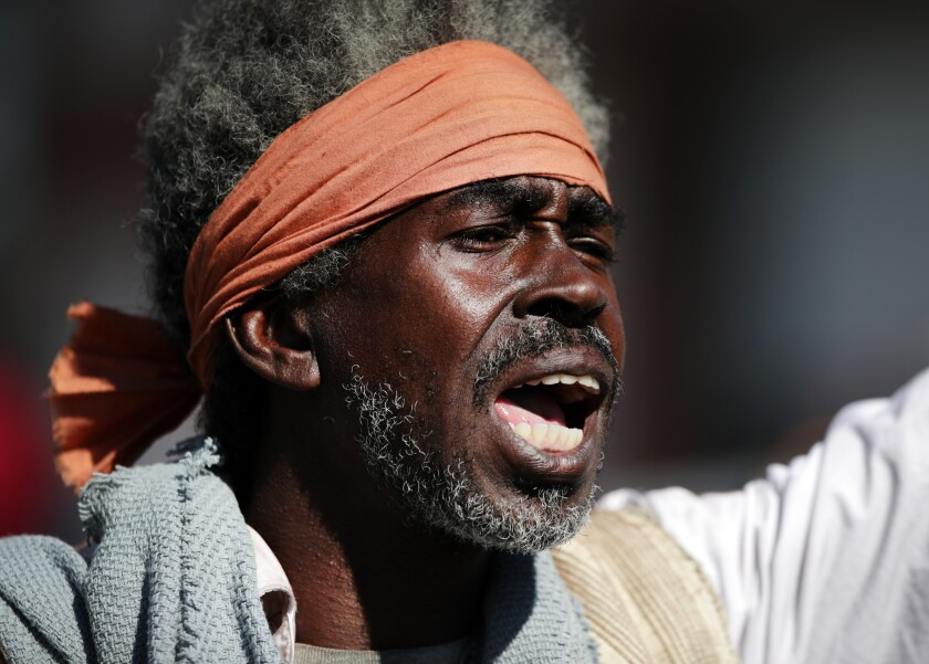 One of the participants in the reenactment, which was directed by New York performance artist Dread Scott and filmed for a documentary.