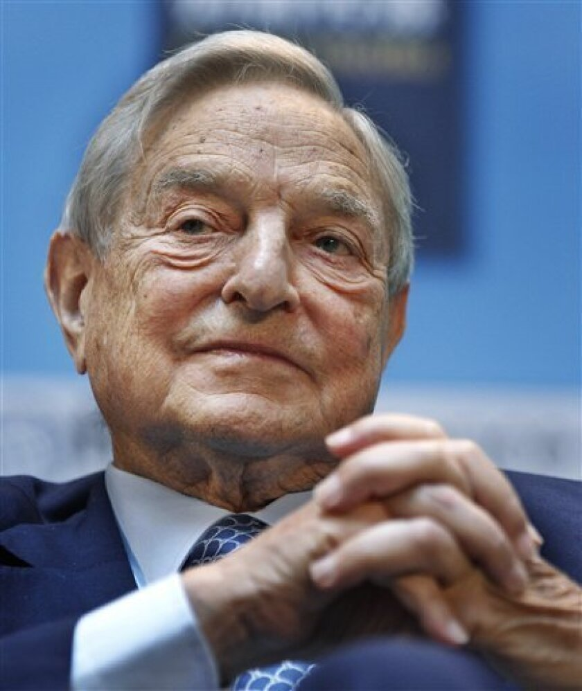 FILE - In this Sept. 24, 2010 file photo, George Soros, chairman of Soros Fund Management, speaks at the IMF/World Bank annual meetings in Washington. The smart money is split on Bank of America. Big hedge fund investors George Soros and John Paulson (not shown) are selling shares of Bank of America. (AP Photo Manuel Balce Ceneta, File)