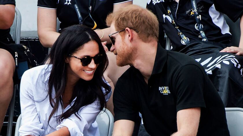 Prince Harry and then-girlfriend Meghan Markle attend the wheelchair tennis competition at the Invictus Games in Toronto in 2017.