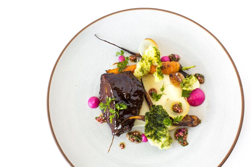 Red wine-braised beef cheeks from George's California Modern is culinary art on a plate.