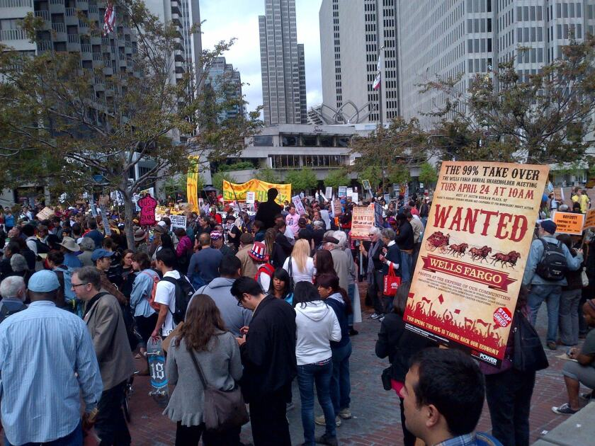 A lawsuit filed in San Francisco federal court accuses Wells Fargo of pressuring workers to open so many accounts and provide so many other services that the employees deceived and defrauded customers across the country. Above, protesters at a Wells Fargo annual meeting in 2012.