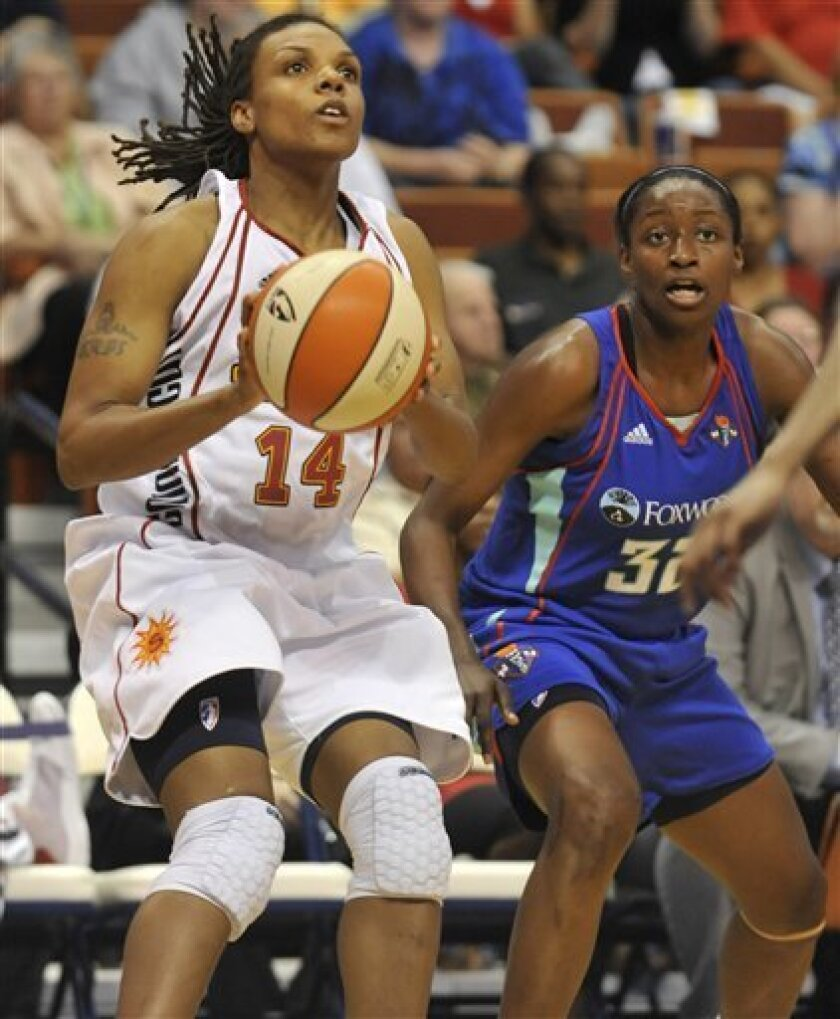Connecticut Sun's Tan White, left, goes up for three points as New York Liberty's Kalana Greene, right, defends during the second half of a WNBA basketball game in Uncasville, Conn., on Friday, June 4, 2010. White was top scorer for the Sun with 18 points. (AP Photo/Jessica Hill)