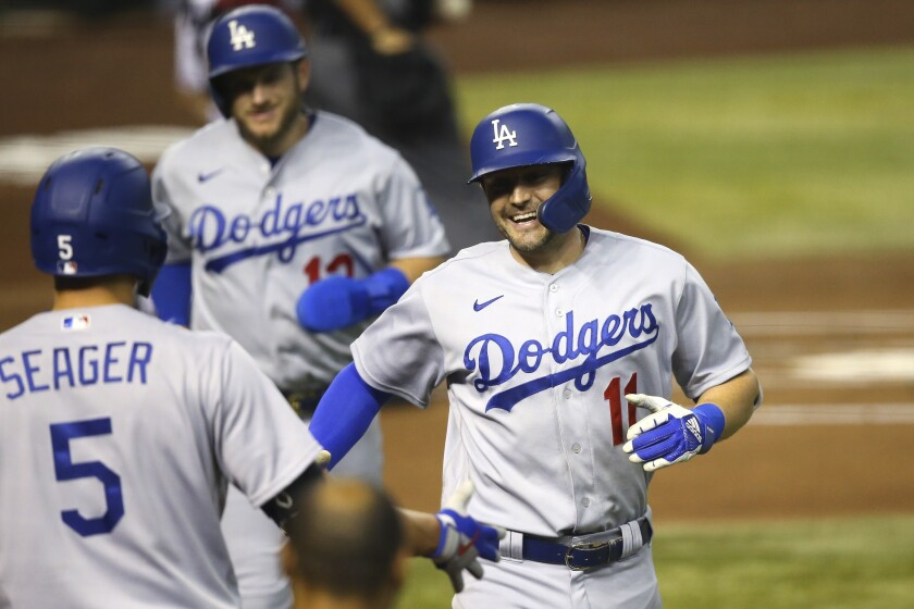 Dodgers outfielder AJ Pollock celebrates with teammate Corey Seager after hitting a two-run home run