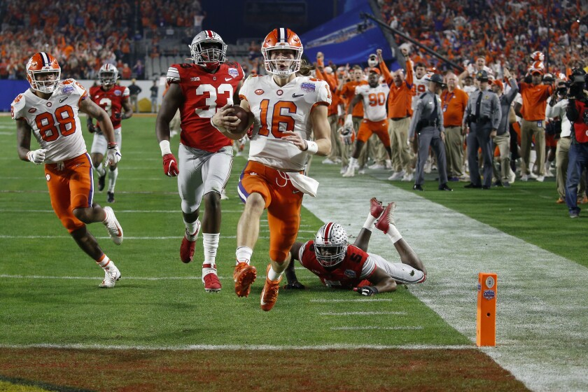Clemson's Trevor Lawrence completes a 67-yard touchdown run in the Fiesta Bowl on Dec. 28, 2019.