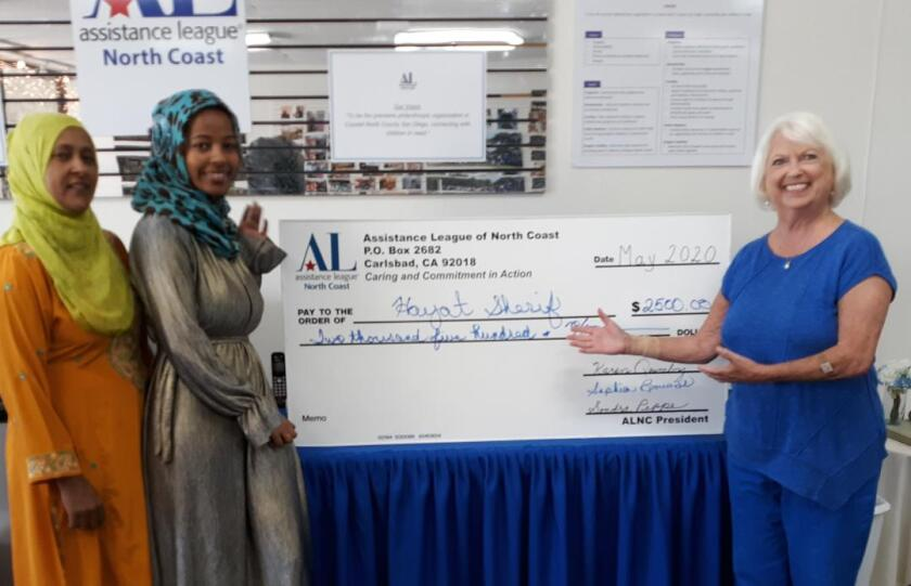 Hayat Sherif and her mother, left, with Sophia Bouvier of the Assistance League of the North Coast.