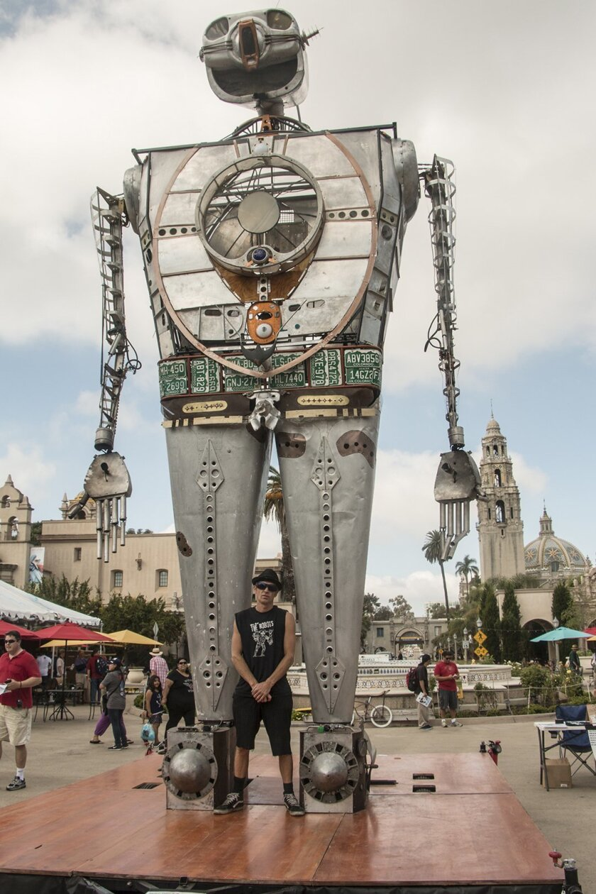 Dominating the Plaza de Panama is 'Robot Resurrection,' seen here with maker Shane Evans during Maker Faire San Diego, held Oct. 3-4, 2015 in Balboa Park.