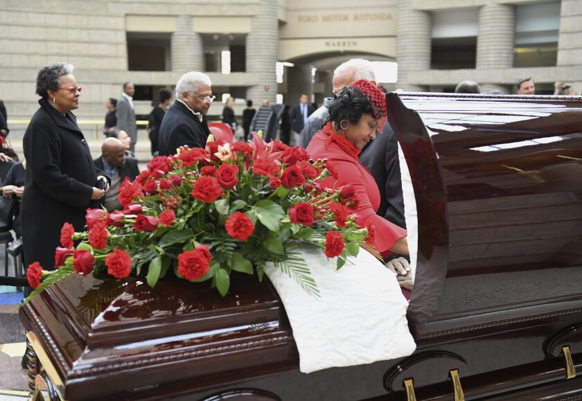 Monica Conyers, widow of the late U.S. Rep. John Conyers, pauses at her husband's casket during visitation services at the Charles H. Wright Museum of African American History in Detroit on Sunday, Nov. 3, 2019. Conyers died Sunday, Oct. 27, at age 90, two years after resigning from the U.S. House. (Robin Buckson/Detroit News via AP)