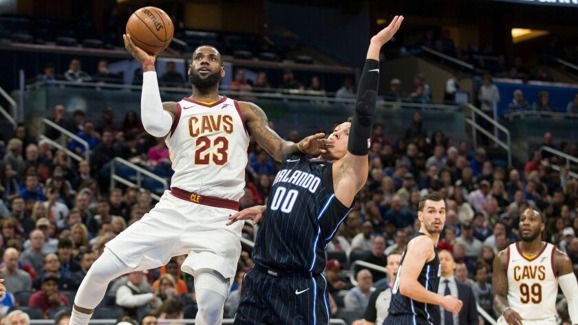 Cleveland Cavaliers forward LeBron James shoots over Orlando Magic forward Aaron Gordon during the first half.