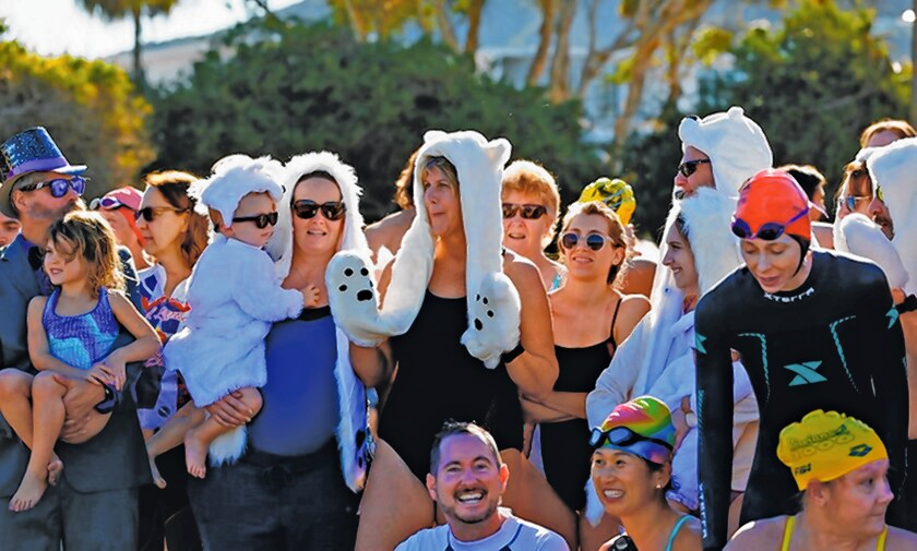 Some participants wore polar bear-inspired outfits for the annual Polar Bear Plunge in La Jolla Shores on New Year's Day 2020.