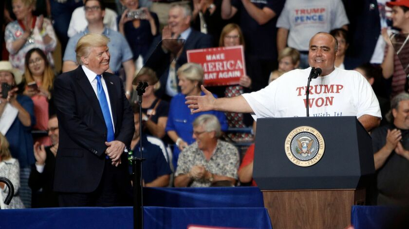 """President Trump and Ohio voter Geno DiFabio at a """"Make America Great Again"""" rally in Youngstown, Ohio."""