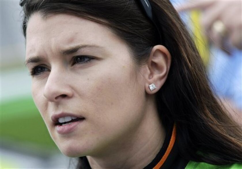 Driver Danica Patrick talks with her crew after qualifying for the Lucas Oil Slick Mist 200 ARCA auto race at the Daytona International Speedway in Daytona Beach, Fla., Friday, Feb. 5, 2010. (AP Photo/Dave Martin)