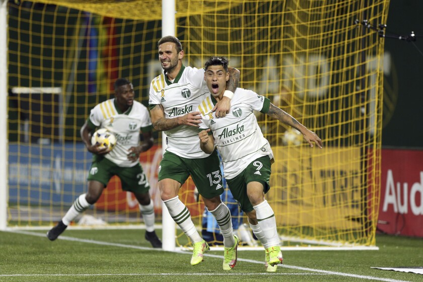 Portland Timbers forward Felipe Mora celebrates his second-half goal against the Colorado Rapids during an MLS soccer match Wednesday, Sept. 15, 2021, in Portland, Ore. (Sean Meagher/The Oregonian via AP)