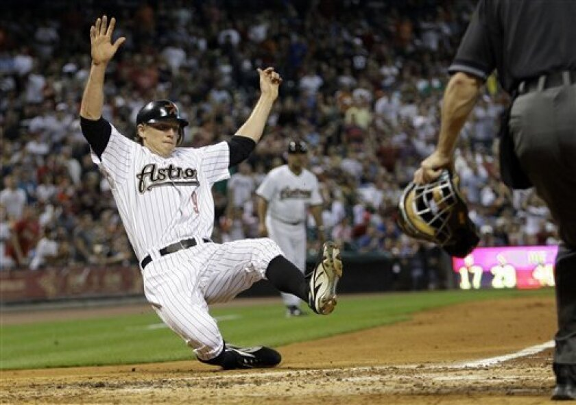Houston Astros' Hunter Pence slides across home plate to score on a hit by teammate Kazuo Matsui, of Japan, during the third inning of their Major League Baseball game against the St. Louis Cardinals Friday, June 6, 2008, in Houston. (AP Photo/David J. Phillip)