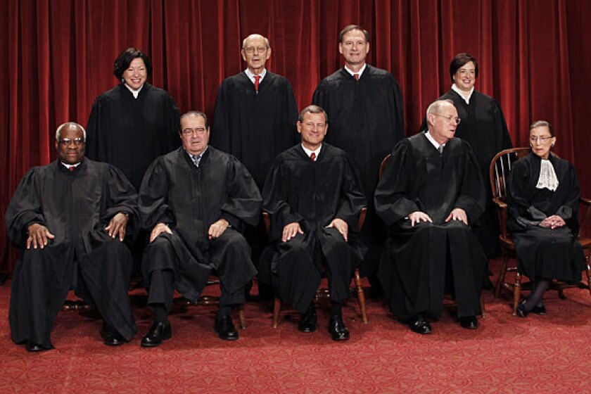 The U.S. Supreme Court poses for a photo in 2010.