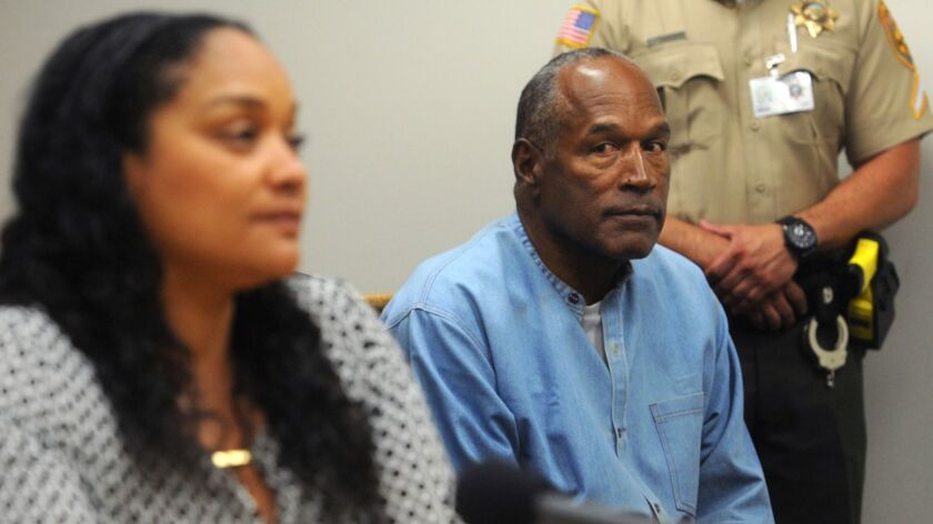 O.J. Simpson listens as his daughter Arnelle Simpson testifies during his parole hearing.