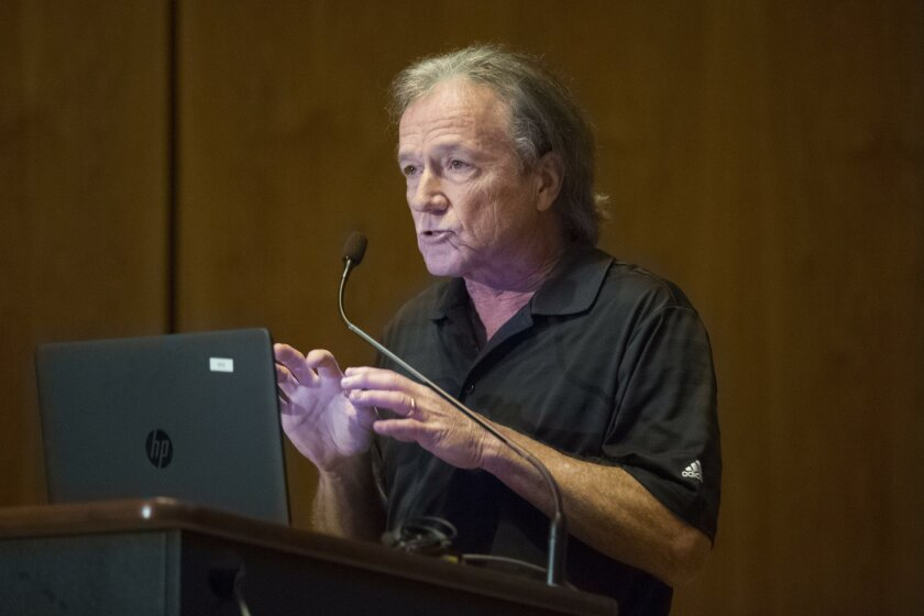 Russ Zinser, a cancer survivor of 30 years, shares his experience and reflections with other survivors Sunday at the Scripps Green Cancer Survivor Day.