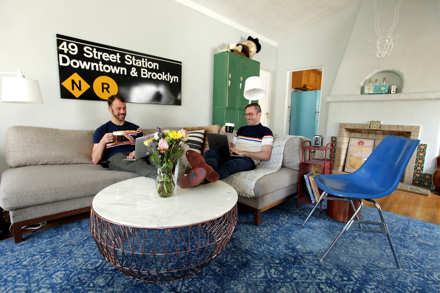 Actors Kit Williamson and John Halbach relax in the living room of their Silver Lake apartment.