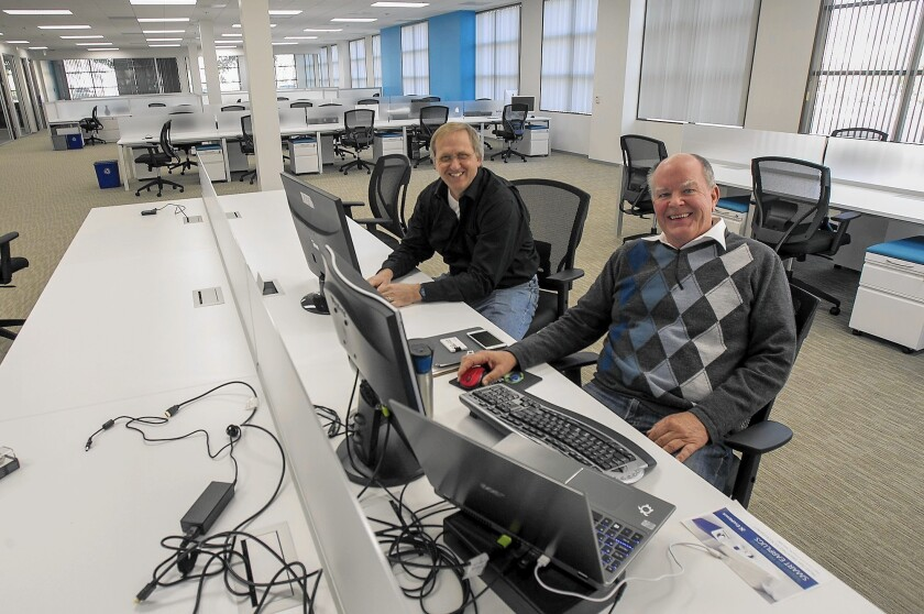 Paul Self and Steve Goold, co-founders of Buildz.com, in their new Irvine tech incubator work space on Friday, January 2.