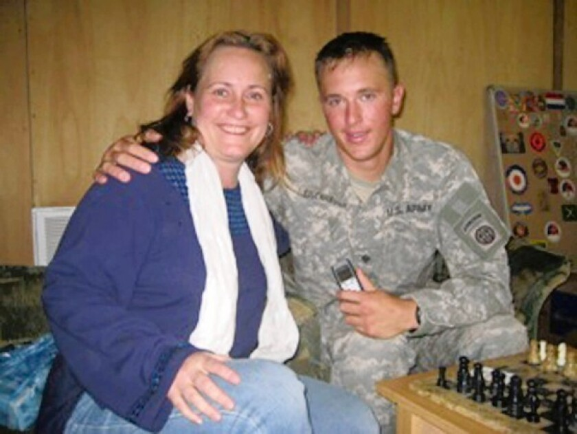 Staff Sgt. Joshua Eisenhauer, 30, with his mother, Dawn Erickson. He faces 17 counts of attempted murder of firefighters and police officers in a shooting Jan. 13 in Fayetteville, N.C.