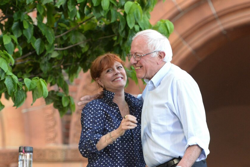 Democratic presidential candidate, Sen.Bernie Sanders, I-Vt., is joined by actress Susan Sarandon as he speaks to a large crowd gathered on the California State University Chico campus during a campaign rally stop on Thursday, June 2, 2016, in Chico, Calif. (Bill Husa/The Chico Enterprise-Record vi