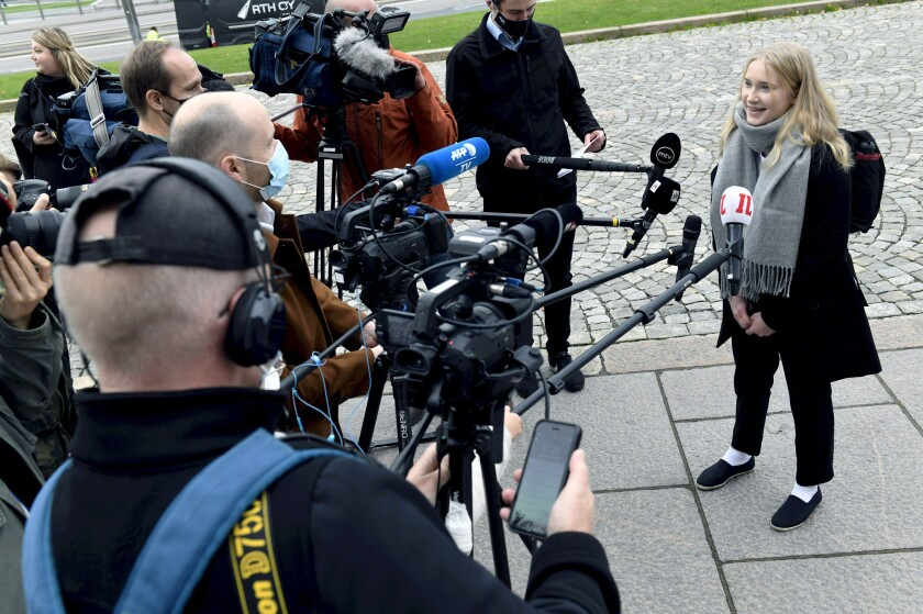"""Aava Murto, is interviewed by members of the media, in Helsinki, Finland, Wednesday, Oct. 7, 2020. A 16-year-old girl has assumed the post of Finnish prime minister for one day in the """"Girls Takeover"""" scheme part of the U.Ns' Day of the Girl to raise more awareness of gender equality in the world. Aava Murto stepped into the shoes of Prime Minister Sanna Marin Wednesday to highlight the impact of technology on gender equality. (Heikki Saukkomaa/Lehtikuva via AP)"""