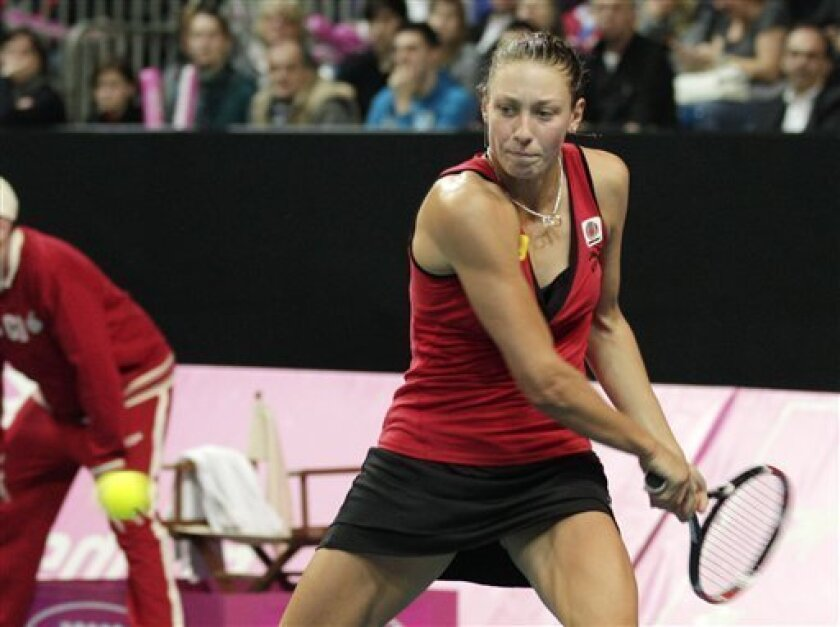 Belgium's Yanina Wickmayer returns the ball to US player Bethanie Mattek-Sands during the World Group Fed Cup match in Antwerp, Belgium, Saturday, Feb. 5, 2011. (AP Photo/Yves Logghe)