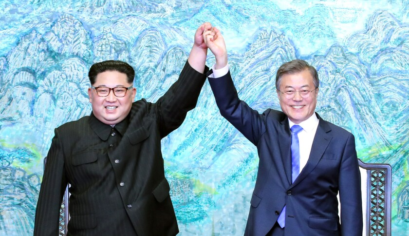 North Korean leader Kim Jong Un, left, and South Korean President Moon Jae-in pose for photographs after a historic meeting in Panmunjom, South Korea, on April 27.