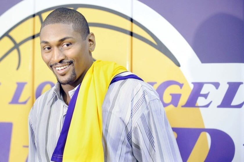 Ron Artest arrives for his introductory news conference with the Lakers.