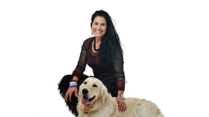 2015.06.03 -- Gina Champion-Cain with her dog Enzo. Gina is President and CEO of American National Investments, Inc. Photo: Rick Nocon