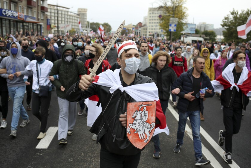 Demonstrators march during an opposition rally to protest official presidential election results on Sunday in Minsk, Belarus.