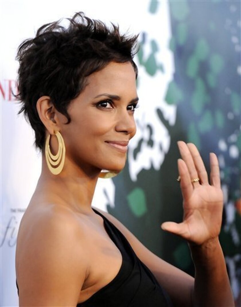 FILE - In a May 25, 2011 file photo, actress Halle Berry attends The Fragrance Foundation's 2011 FiFi Awards at The Tent at Lincoln Center, in New York. Police have arrested a suspected stalker at the home of Halle Berry. Sgt. Enrique Mendoza says off-duty Los Angeles police officers hired by Berry saw the man climbing over a locked security gate at Berry's Hollywood Hills home shortly before 11:30 p.m. Monday, July 11, 2011. On-duty officers were called and arrested 27-year-old Richard Franco on suspicion of stalking. He remained jailed on Tuesday. (AP Photo/Evan Agostini, File)