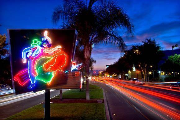 """Neon artwork stands along Santa Monica Boulevard presented by West Hollywood in collaboration with the Museum of Neon Art. The work is a part of four neon displays called """"On Route — 66 Lights."""" Along this street, you'll find nightclubs and restaurants with names such as FUBAR and Mother Lode"""