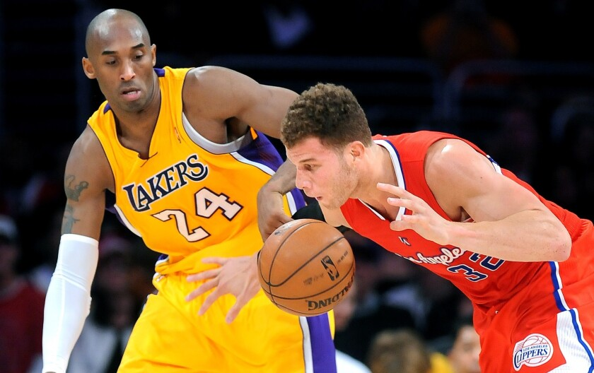 Lakers guard Kobe Bryant tries to steal the ball from Clippers forward Blake Griffin during a game at Staples Center on Feb. 14, 2013.