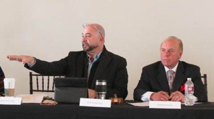 The Merchants Association's new board president, architect Claude-Anthony Marengo (left), said he envisions the group as an advocate to help business owners find 'loopholes' allowing them to navigate more rapidly through the city permitting process. Board vice-president Mark Krasner looks on.