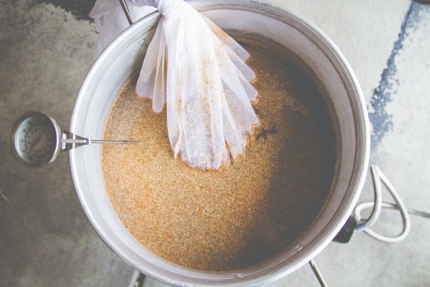 Homebrewing beer in a kettle.