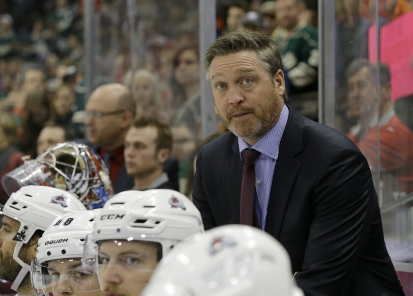 FILE - In this Feb. 7, 2015, file photo, Colorado Avalanche head coach Patrick Roy watches from the bench during the third period of an NHL hockey game against the Minnesota Wild in St. Paul, Minn. This depicts Roy's style: Backing his players, even after dreadful losses, and keeping an even-keel demeanor. That took nearly a decade to sink in as he learned how to maintain his cool while coaching the Quebec Remparts of the Quebec Major Junior Hockey League. He realized that yelling didn't lead to goals and that screaming only caused players to tune out.(AP Photo/Ann Heisenfelt, File)