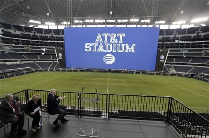 The new name of Dallas Cowboys stadium is unveiled during a news conference announcing the new AT&T Stadium Thursday, July 25, 2013, in Arlington, Texas. (AP Photo/LM Otero)