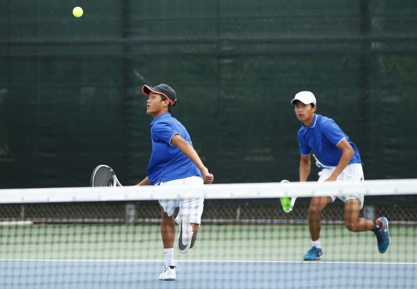 Rancho Bernardo's Michael Blando (left) and brother Jay Blando teamed up for the doubles crown.