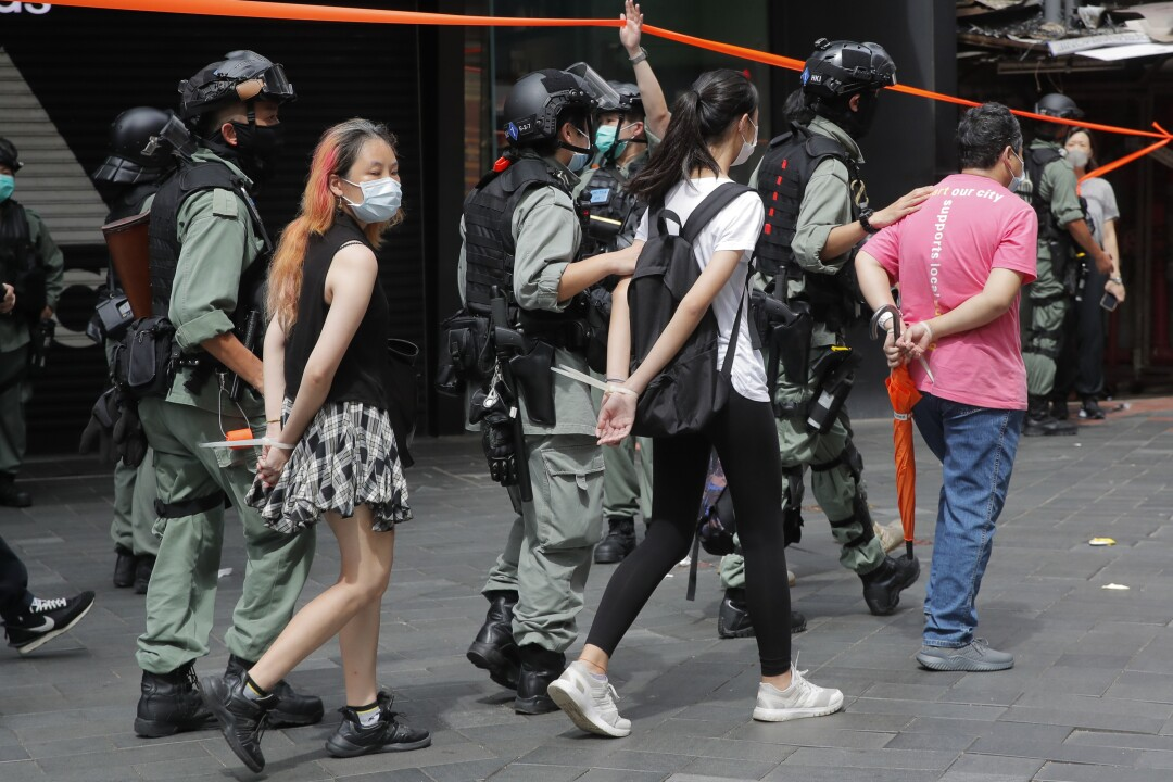 Hong Kong police detain security law protesters in Causeway Bay on Wednesday.