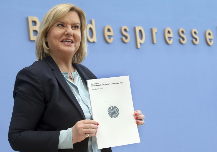 Eva Hoegl, German Federal Parliament's commissioner for the German military, presents her first annual report on the situation of the Bundeswehr in Berlin, Germany, Tuesday, Feb. 23, 2021. Hoegl says that the number of suspected far-right incidents in the military's ranks increased to 477 last year from 363 in 2019. (Wolfgang Kumm/dpa via AP)
