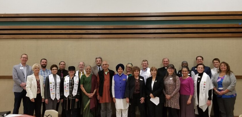 """The Poway Interfaith Team is sponsoring its 11th Annual Interfaith Thanksgiving Service at 7 p.m. Nov. 20, San Rafael Catholic Church, 17252 Bernardo Center Drive. The community wide event will include leaders from diverse faith communities sharing reflections, prayers and music on the theme, """"Neighbors Standing Together in Gratitude."""" The guest speaker is Greg Anglea, CEO of Interfaith Community Services. Canned goods and donations from attendees will go to Escondido-based nonprofit Interfaith Community Services. Light refreshments after service. Pictured are representatives and board members of POINT along with presenters for the 2018 Interfaith Thanksgiving Service held at the Church of Jesus Christ of Latter-day Saints in Poway. For more information, call Rev. Dr. Abigail Albert at (858) 487-8885."""