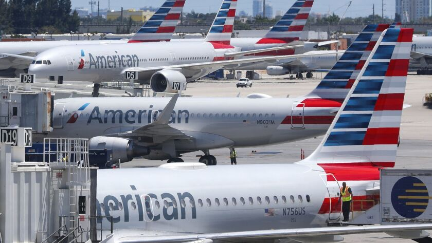 In this Wednesday, April 24, 2019, photo, American Airlines aircraft are shown parked at their gates